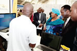 Minister of Higher & Tertiary Education,Science & Technology Development, Hon Oppah Muchinguri Kashiri and HIT Vice Chancellor Eng. Q.C Kanhukamwe at the HIT Stand ZITF 2015 as Software Engineering Lecturer Mutandavari demonstrates the e-government service application tracker - an innovation on government - citizen interaction.